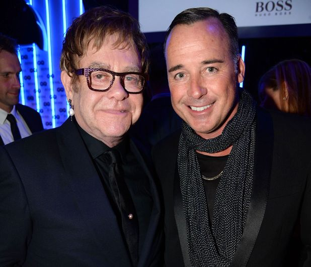 Sir Elton John and David Furnish arriving at the GQ Men of the Year Awards held at the Royal Opera House