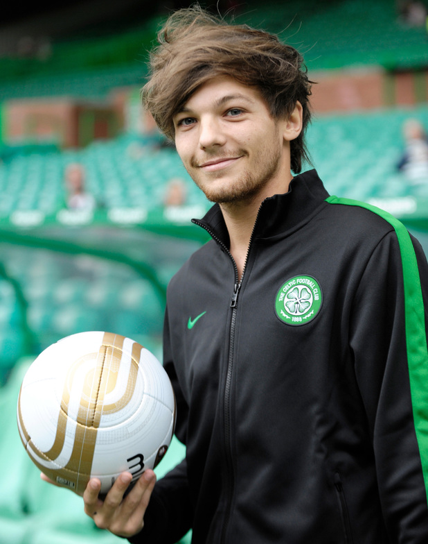 One Direction's Louis Tomlinson warms up before playing for Celtic XI in the Stiliyan Petrov #19 Legends charity football match