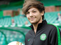 1D's Louis sick during football match
