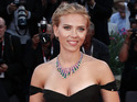 Scarlett Johansson smoulders at Under the Skin Venice Festival premiere.