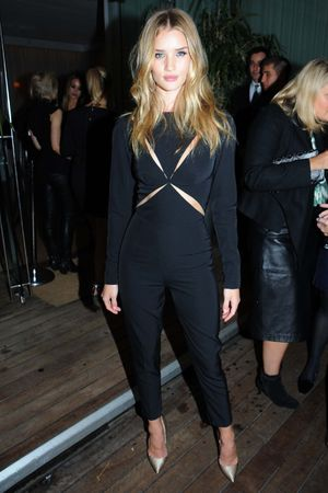 Rosie Huntington-Whiteley and Annabelle Wallis at Elle magazine's London Fashion Week cocktail party at the Sanderson Hotel, London.