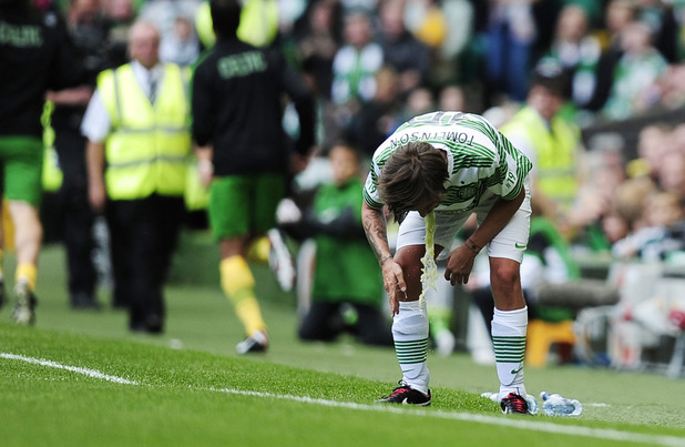 One Direction's Louis Tomlinson playing for Celtic XI in the Stiliyan Petrov #19 Legends charity football match. Tomlinson is injured and throws up at the side of the pitch after being substituted.
