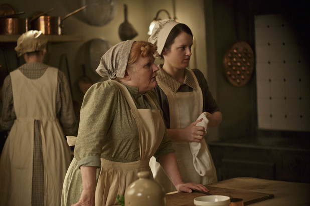 Lesley Nicol as Mrs Patmore and Sophie McShera as Daisy Mason in Downton Abbey series 4.