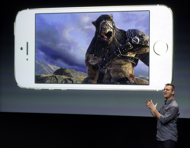 Donald Mustard, CEO of Epic Games, speaks on stage during the introduction of the new iPhone 5s