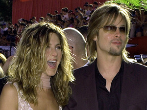 Jennifer Aniston is joined by husband Brad Pitt as they arrive at the 54th Annual Primetime Emmy Awards Sunday, Sept. 22, 2002