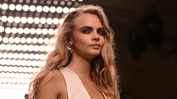 Cara Delevingne walks the runway for Topshop at London Fashion Week 2013