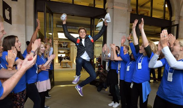 15 year old Jesse Green jumps for joy as he leaves the Apple store in Covent Garden with his new iPhone