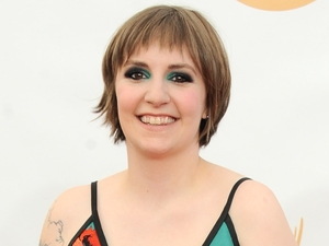 Lena Dunham arrives at the 65th Primetime Emmy Awards at Nokia Theatre on Sunday Sept. 22, 2013, in Los Angeles