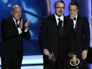 """Breaking Bad creattor Vince Gilligan"" accepts the award for outstanding drama series as co-stars Dean Norris, left, and Aaron Paul look on at the 65th Primetime Emmy Awards"
