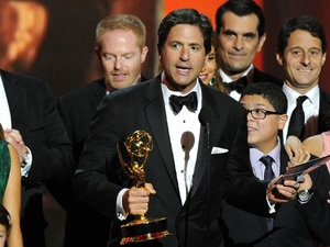"Steven Levitan and the cast and crew of '""Modern Family'"" accept the award for outstanding comedy series at the 65th Primetime Emmy Awards"
