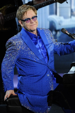 "Elton John performs '""Home Again'"" at the 65th Primetime Emmy Awards at Nokia Theatre on Sunday Sept. 22, 2013, in Los Angeles."