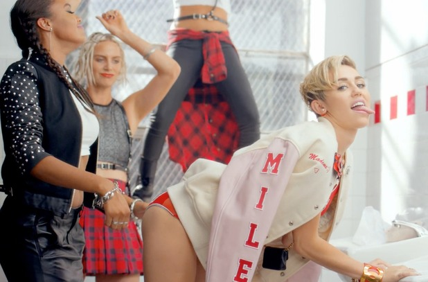 Miley Cyrus twerks and sticks her tongue out in '23'