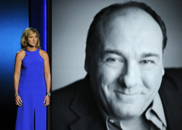 Edie Falco presents a tribute to James Gandolfini on stage at the 65th Primetime Emmy Awards
