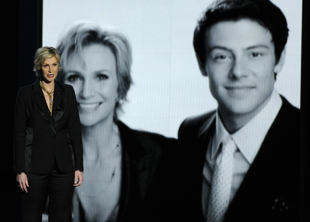 Jane Lynch presents a tribute to Cory Monteith on stage at the 65th Primetime Emmy Awards