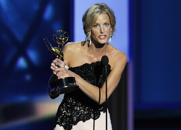 "Anna Gunn accepts the award for outstanding supporting actress in a drama series for her role on '""Breaking Bad'"" at the 65th Primetime Emmy Awards"