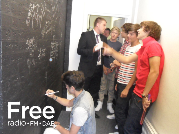 One Direction signing the Free Radio wall