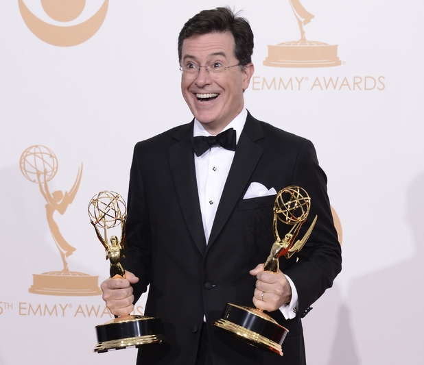 "Stephen Colbert, winner of the best writing for a variety series award and best variety series award for ""The Colbert Report"" poses backstage at the 65th Primetime Emmy Awards"