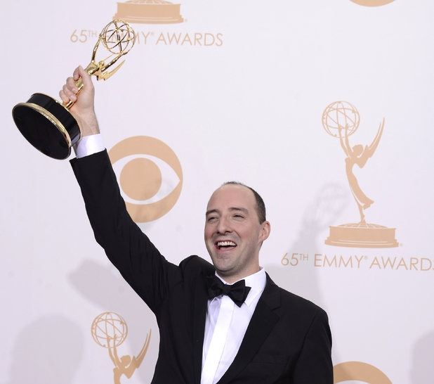 "Tony Hale poses backstage with the award for outstanding supporting actor in a comedy series for his role on ""Veep"" at the 65th Primetime Emmy Awards"