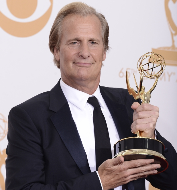 "Jeff Daniels poses with the award for outstanding lead actor in a drama series for his role on '""The Newsroom' at the 65th Primetime Emmy Awards"
