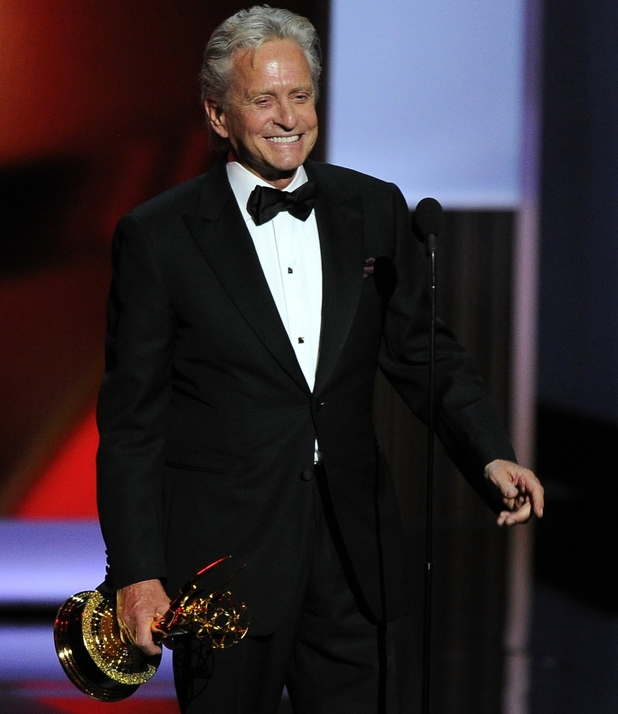 "Michael Douglas accepts the award for for outstanding lead actor in a miniseries or movie for his role in '""Behind The Candelabra' at the 65th Primetime Emmy Awards"