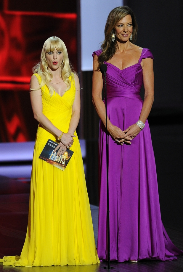 Anna Faris, wearing Monique Lhuiller, left, and Allison Janney, wearing David Meister Signature, present the award for outstanding writing for a miniseries, movie or a dramatic special at the 65th Primetime Emmy Awards