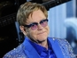 Elton John swears at paparazzi - video