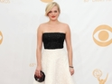 Elisabeth Moss talks short hair and Miley Cyrus on Emmy's red carpet.