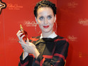 'Dark Horse' singer turns heads as she unveils her Killer Queen fragrance in Berlin.