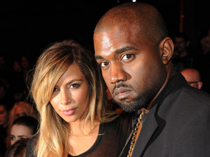 Kanye West and Kim Kardashian attend the Givenchy Spring/Summer 2014 show during Paris Fashion Week