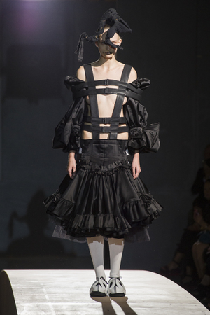 A model presents a creation as part of Comme Des Garcons ready-to-wear Spring/Summer 2014 fashion collection, presented Saturday, Sept. 28, 2013 in Paris. (AP Photo/Zacharie Scheurer)