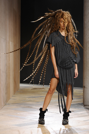 A model presents a creation as part of Junya Watanabe's ready-to-wear Spring/Summer 2014 fashion collection, presented Saturday, Sept. 28, 2013 in Paris. (AP Photo/Zacharie Scheurer)