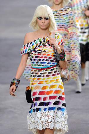 Cara Delevingne on the catwalk at Chanel's ready-to-wear Spring/Summer 2014 fashion collection show at Paris Fashion Week