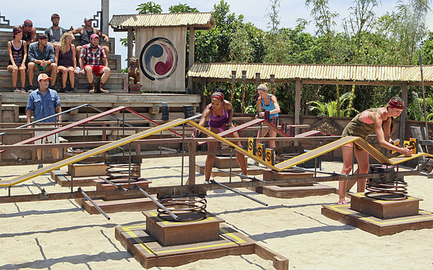 Jeff Probst watches as Candice Cody, Marissa Peterson and Rachel Foulger compete in the Redemption Challenge