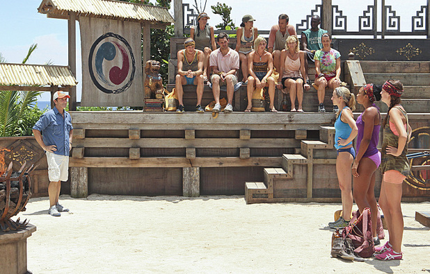 Jeff Probst and the Galang Tribe watch as Candice Cody, Marissa Peterson and Rachel Foulger get ready to compete in the Redemption Challenge