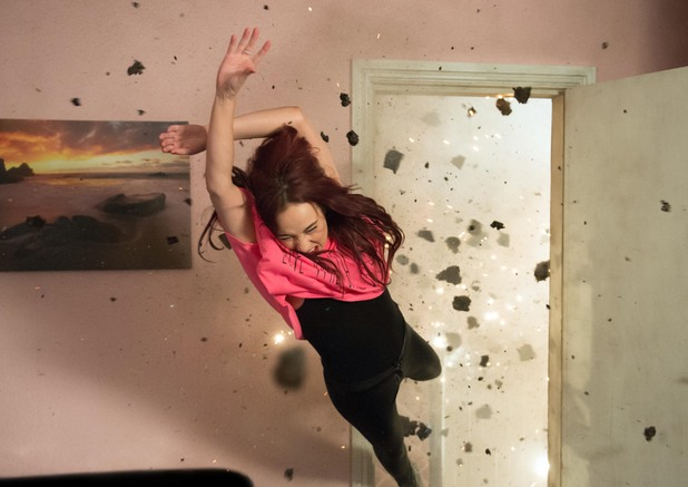 Sinead is thrown by the explosion.