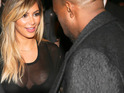 The rapper is caught taking a keen interest in Kardashian's low-cut dress.