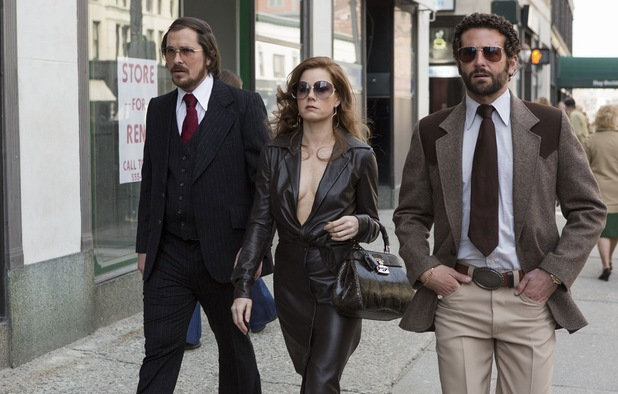 Amy Adams, Christian Bale, Bradley Cooper in American Hustle.