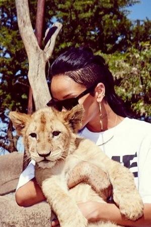 Rihanna cuddles a lion cub