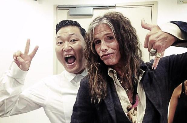 Psy and Steven Tyler pose for Twitpic.