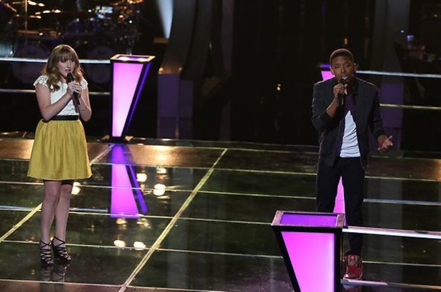 Anthony Paul and Caroline Pennell sing against each other in part 1 of 'The Voice' battles.