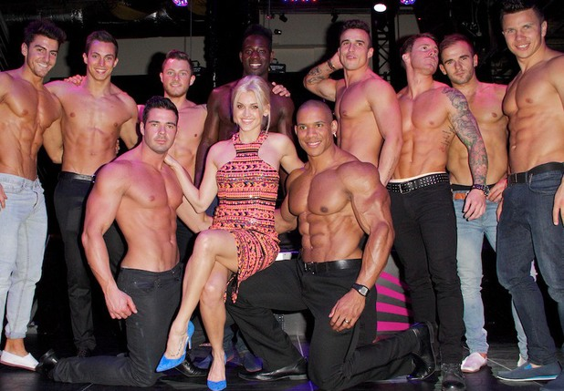 Ashley Roberts poses with the Dreamboys