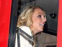Britney Spears enjoys a tour of London on an open-top double decker bus.