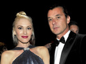 Gwen Stefani cradles stomach at an LA gala following pregnancy reports.