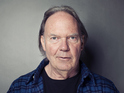 Neil Young posing for a portrait at The Carlyle hotel in New York.