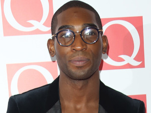 Tinie Tempah arriving at The Q Awards 2013 at Grosvenor House