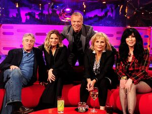 Graham Norton poses with Robert De Niro, Michelle Pfeiffer, Jennifer Saunders and Cher during filming for the Graham Norton Show at The London Studios