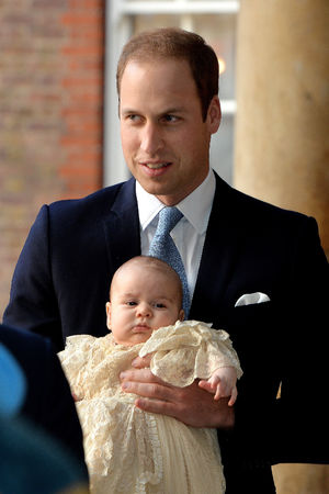 Prince William holds his son Prince George prior to the christening