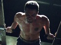 Stephen Amell strips w
