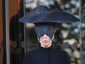 Lady Gaga seen leaving her london hotel wearing a black head piece for halloween. The born this way singer was spotted leaving her london hotel and heading to a london studio for promotion.