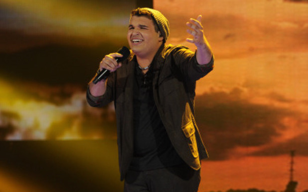 Carlos Guevara performs on The X Factor USA first live show
